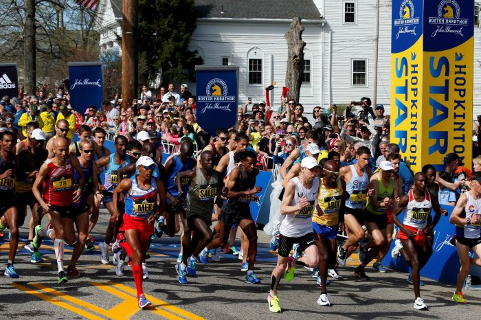 The elite men's runners leave the starting line for the 121st running of the Boston Marathon in Hopkinton
