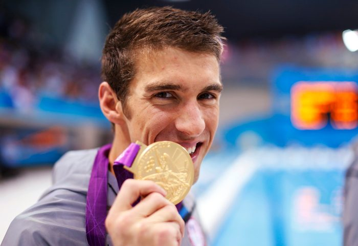 Michael Phelps of the U.S. poses with his gold medal after winning the men's 4x100m medley relay final during the London 2012 Olympic Games at the Aquatics Centre